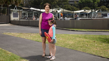 """""""I don't know what to do, I'm dreading it"""": Chloe Groom with her daughter Iris outside Victoria Park pool in Camperdown."""