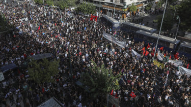 Thousands of people gather for an anti-fascist demonstration outside court in Athens on Wednesday.