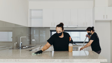 Whizz cleaners wear face masks and gloves to perform a deep clean.