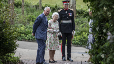Prince Charles, pictured with Queen Elizabeth II at a reception for Her Majesty at the G7 summit, called on world leaders to respond to climate change with urgency.