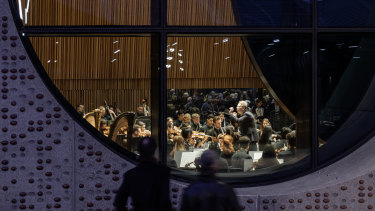 'Portholes' in the Melbourne Conservatorium of Music allow passers-by to peer in and observe a performance.