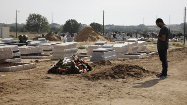 A man prays at the grave of Moshe Agadi, who was killed by a rocket fired from Gaza into the Israeli city of Ashkelon.