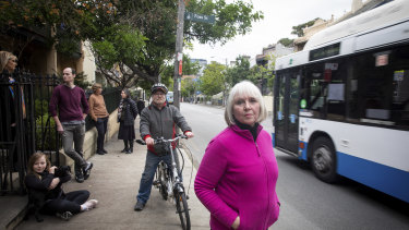 Glebe resident Di Anstey (front) and her neighbours say a pop-up cycleway on Bridge Road will make life more difficult for them.