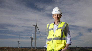 Minister for Climate Change and Sustainability Shane Rattenbury, pictured at the Crookwell 2 wind farm, said a peak in electricity prices would stabilise in the 2020s.