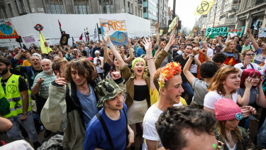 Climate activists dance during a protest at the intersection near Oxford Circus London Underground station on Wednesday.