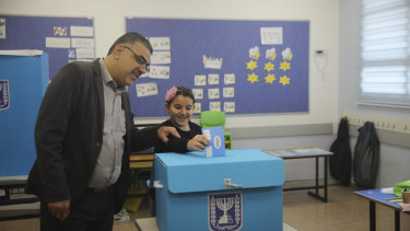 A man and his daughter vote during elections in Tamra, an Arab town in Israel.