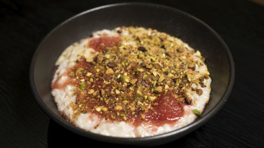 The porridge comes topped with pistachio, clotted cream, pear and rhubarb stew.