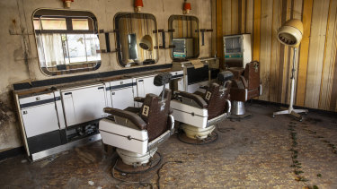 An abandoned hair salon in Namie. Despite government efforts, only a fraction of the town's residents have returned.