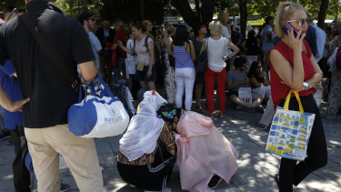 Tourist hug each other in Syntagma square after a strong earthquake hit near the Greek capital of Athens.