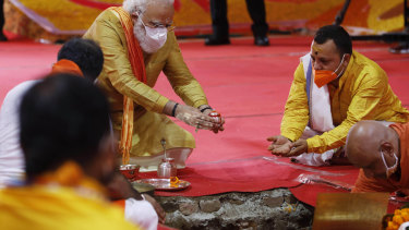 Indian Prime Minister Narendra Modi performs the groundbreaking ceremony of a temple dedicated to the Hindu god Ram in Ayodhya, India, last year. Modi  wants to see the Indian economy double in size by 2024.
