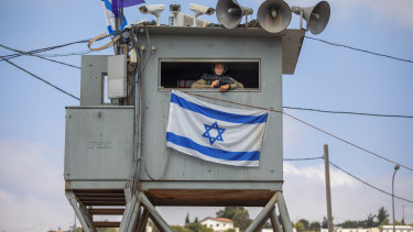An Israeli soldier stands guard at the Tapuach junction next to the West Bank city of Nablus on Tuesday.