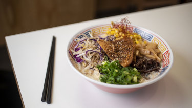 The vegan miso ramen is made with a base of soy milk and topped with grilled seasoned tofu.