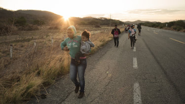 A group of Central American refugees and asylum seekers walk along a road in the town of Santiago Niltepec, Oaxaca state, Mexico.