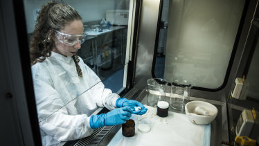 A lab technician at work at the Centre for Digestive Diseases. The centre manufactures faeces pills.