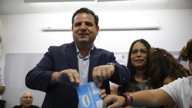 Israeli Arab politician Ayman Odeh casts his vote in Haifa, Israel.