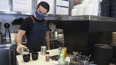 Barista Will Hobbs wearing a mask at work on the northern beaches.