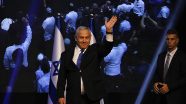 Israeli Prime Minister Benjamin Netanyahu addressees his supporters at party headquarters after elections in Tel Aviv in the early hours of Wednesday.