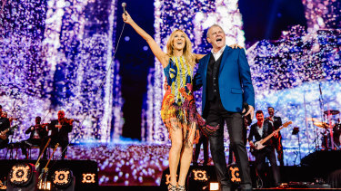 John Farnham onstage with Celine Dion.