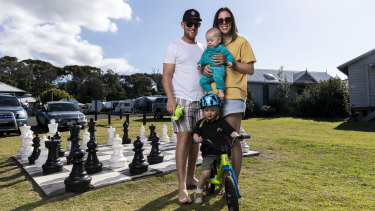 Catherine Roos and Simon Ebeling and kids Homer and Ted, who are enjoying a getaway at Bateau Bay.