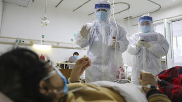 Medical workers check on the conditions of patients in Jinyintan Hospital, designated for critical COVID-19 patients, in Wuhan.