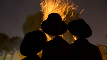 "Ultra-Orthodox Jews gather next to bonfires during the Jewish holiday of Lag Ba'Omer in Israel last week. Avigdor Lieberman accused Netanyahu of ""capitulating to the ultra-Orthodox""."