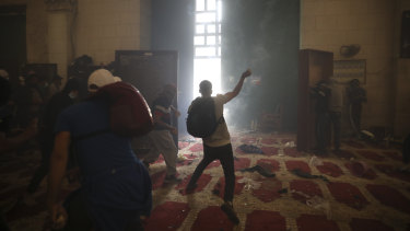 Palestinians clash with Israeli security forces at the al-Aqsa Mosque compound in Jerusalem's Old City.