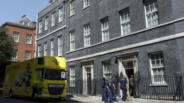 Removalists enter 10 Downing Street on Thursday as Boris Johnson moves in.