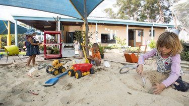 Audrey Wood-Ingram, Finn Weiland and Caitlyn Weiland play in the sand pit at the Mallacoota preschool.