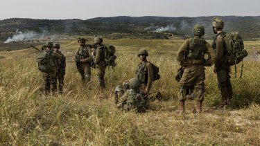 Israeli troops take part in a drill in northern Israel in May near the border with Lebanon.