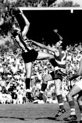Terry Waters, left, in action against Footscray in 1971.
