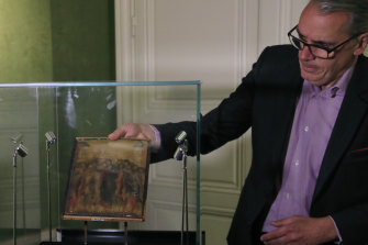 Art expert Stephane Pinta with the 13th-century painting by Italian master Cimabue. The painting was found hanging in a house in northern France.