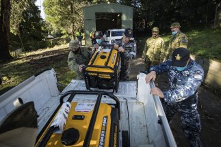 Troops prepare to distribute generators to residents in the storm-ravaged Dandenong Ranges.