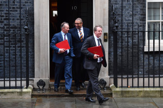 Leaving the first Cabinet meeting post-election are the government's Secretary of State for Wales, Simon Hart, the Conservative Party co-chairman, James Cleverly, and the Secretary of State for Scotland, Alister Jack.