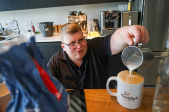 At your service: Kane Cross is the in-house barista in a Docklands office, in a new employment program for people with disability.