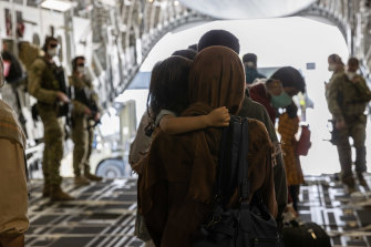 Afghanistan evacuees arrive at Australia's main operating base in the Middle East, on board a Royal Australian Air Force C-17A Globemaster.