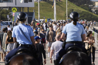 Mounted police patrol at Bondi Beach as part of public health order compliance operations on Sunday.