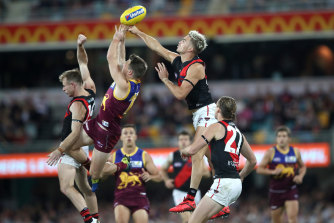 Matt Guelfi of the Bombers flies high to spoil a mark.