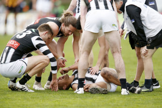 Dampener: Collingwood's Alex Woodward has injured his knee and will require a reconstruction.