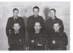 Four of the crew on the downed bomber. Don Wills (centre rear), Tony Hundy (front left), Keith Tanner (centre front, RAF pilot) and Ronald Dent (front right).