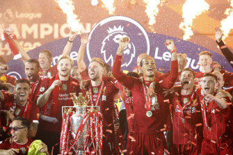 Liverpool players celebrate a long-awaited Premier League triumph in July.