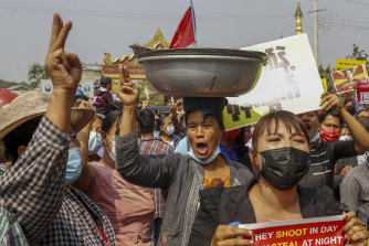 Demonstrators protest against the military junta's arrest and chagrining of National League for Democracy party MPs in Mandalay, Myanmar.