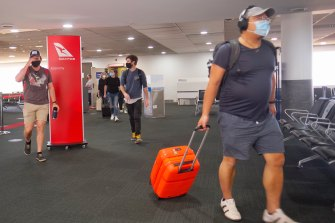 Passengers arriving at Melbourne Airport from Brisbane this afternoon.