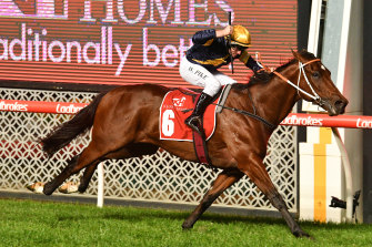 Willie Pike steers Masked Crusader to victory in the William Reid Stakes at Moonee Valley on Friday night.