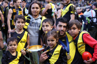 Marlion Pickett with his family after Richmond's grand final triumph in 2019.