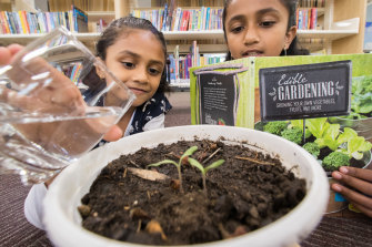 Abigail (left) and Judith Manalil at Sam Merrifield Library in Moonee Ponds, which runs a seed library.