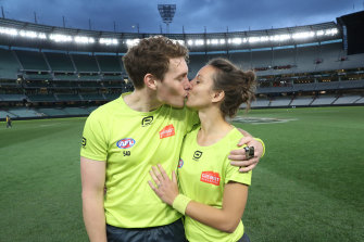 Umpires Dillon Lee and Eleni Glouftsis seal their engagement with a kiss.