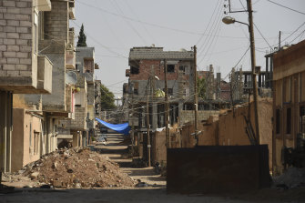 The town of Darbasiyah has been all but abandoned by citizens fearing a Turkish attack.