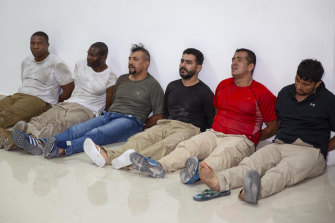 Suspects in the assassination of Haiti's President Jovenel Moise are shown to the media in Port-au-Prince last week.