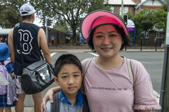 Jie Cao, who visited China a month ago and is feeling fine, with her son Jason.