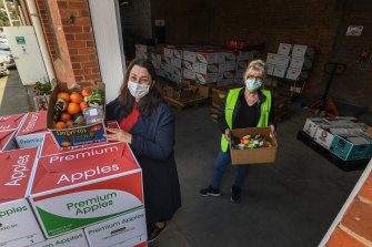 Grace Grieve (right) and Lisa McKenzie preparing food to be delivered to people in isolation.